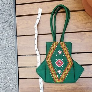Small embroidered green hand bag